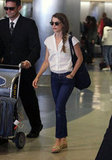 Keri Russell wore jeans and a white button-down shirt at LAX.