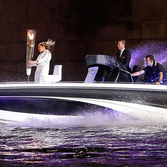 David Beckham Pictures With Olympic Torch at 2012 Olympics Opening Ceremony