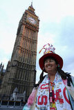 A fan posed under Big Ben.