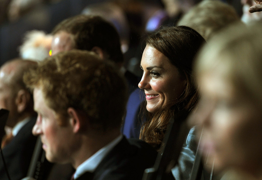 Kate smiled next to Prince Harry.