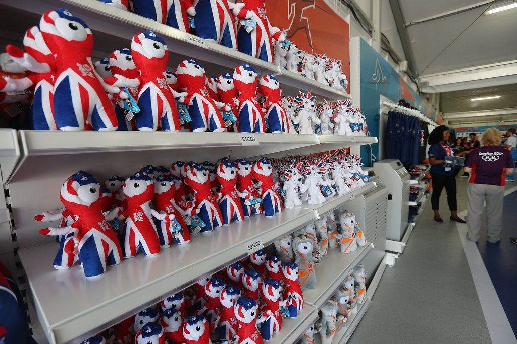 Rows of Olympic mascot toys sit at a store in the Olympic Park.