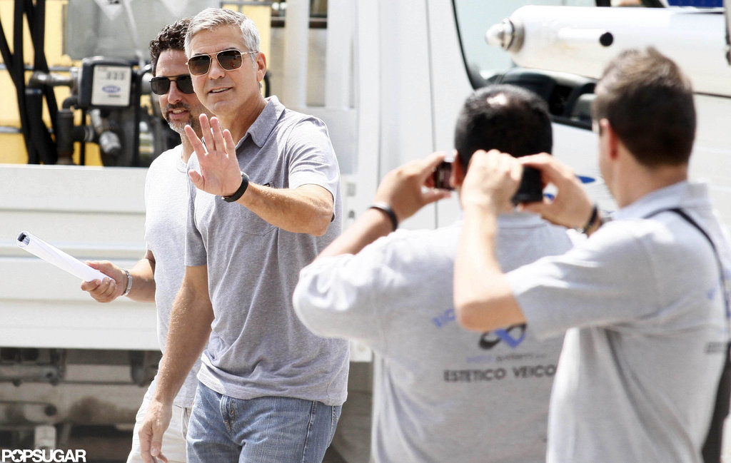 George Clooney waved to locals.
