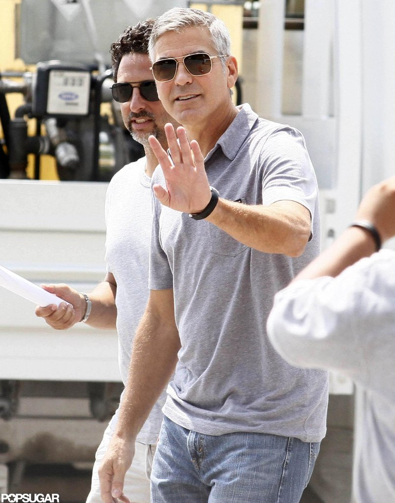 George Clooney waved to fans and photographers.