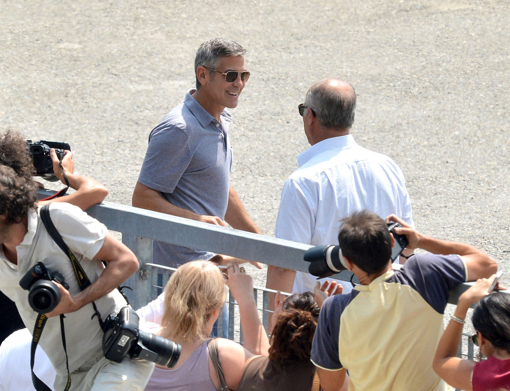 George Clooney drew a crowd while filming a commercial in Sarnico, Italy, in July.