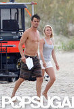 Josh Duhamel carried a script on the beach.