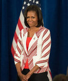 Michelle greeted members of Team USA in a red chevron-printed Thakoon blazer ($435) with a red peplum tank top peeking through.