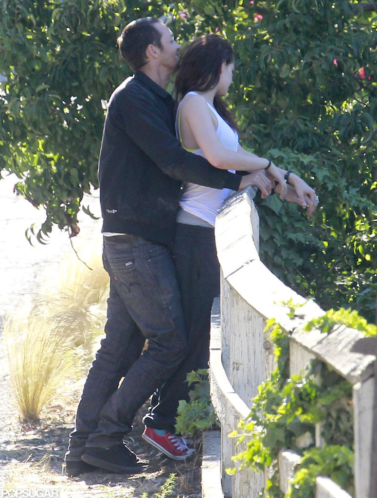 Rupert Sanders hugged Kristen Stewart from behind.