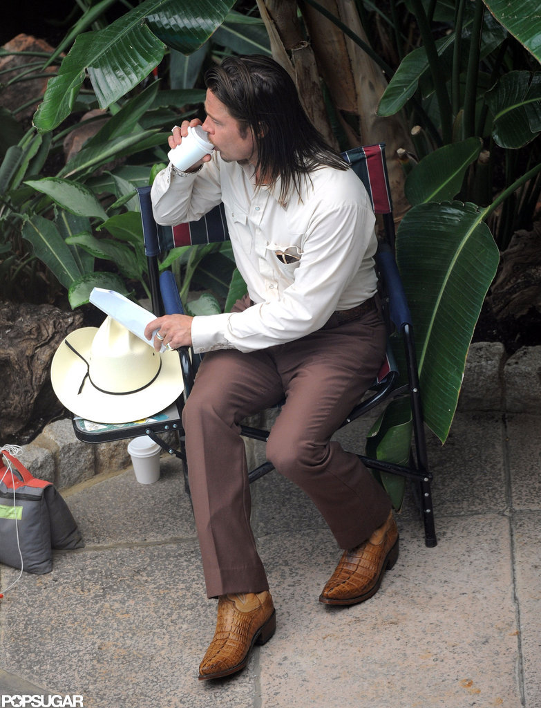 Brad Pitt took a drink break on the set of his latest project.