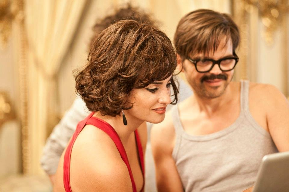 Penélope Cruz was done up in a bright red dress while on the set of Campari's 2013 calendar shoot. Source: Facebook user Campari