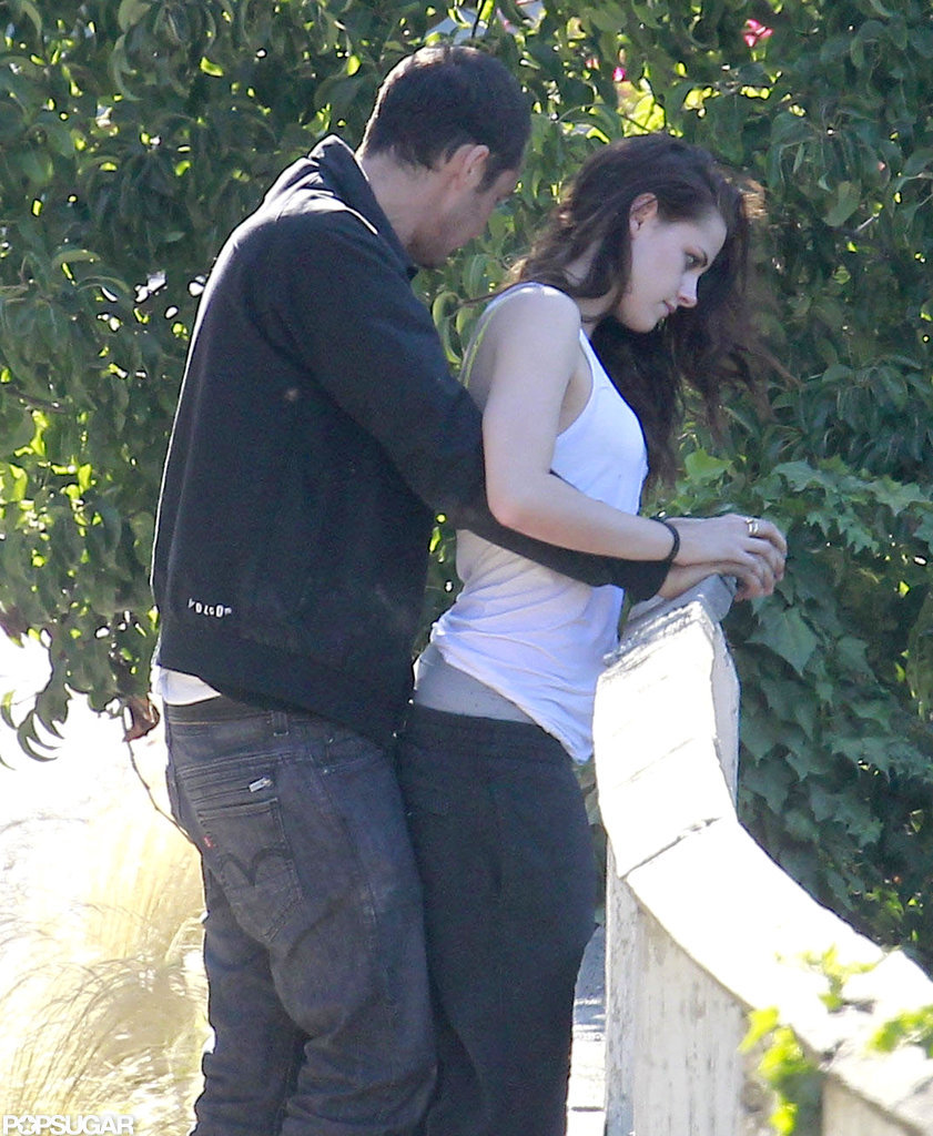 Rupert Sanders cuddled up to Kristen Stewart outside.