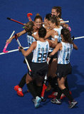 The Argentina hockey team celebrated with a group hug.