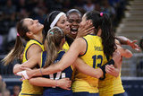 Brazil players celebrated during a women's volleyball preliminary match.