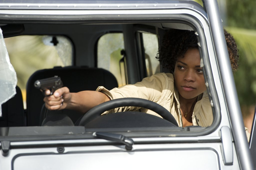 Naomie Harris plays Eve, a multitalented lady who can drive and shoot a gun at the same time.