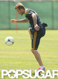 David Beckham dribbled the soccer ball at practice.