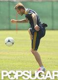 David Beckham dribbled the soccer ball at practice.