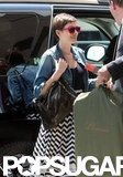 Anne Hathaway carried a Stella McCartney bag.