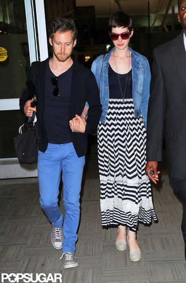 Anne Hathaway arrived in NYC with fiancé Adam Shulman.