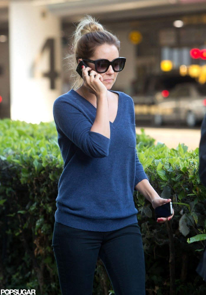 Lauren Conrad arrived at LAX talking on her phone.