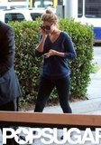 Lauren Conrad talked on the phone as she left the airport in LA.