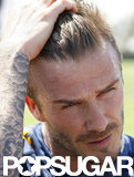 David Beckham ran his hand through his hair.