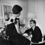 Yves Saint Laurent's mother, Madame Mathieu Saint Laurent, sat with her son in a one-shouldered Christian Dior dress in 1960.