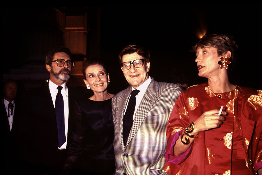 Talk about power players — Yves Saint Laurent hung out with Audrey Hepburn and Loulou de la Falaise at a fashion event.