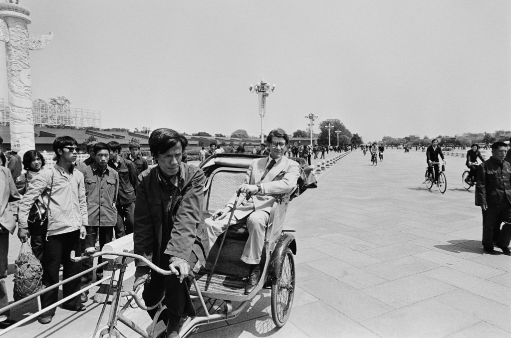 He took a tour of Tiananmen Square as an official guest of the government of the People's Republic of China. He was invited to Beijing to present a retrospective of his work at the city's fine arts museum in 1985.