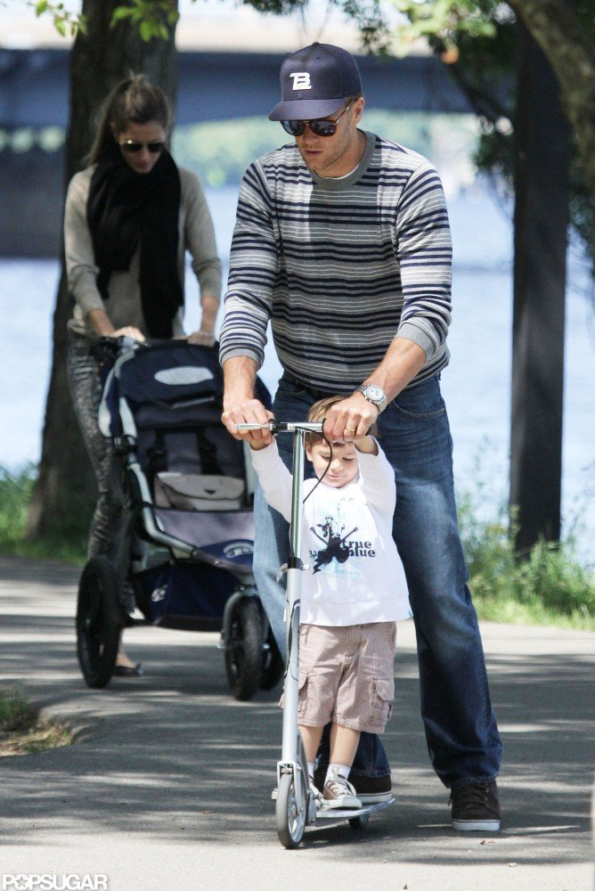 Tom Brady took his eldest son, Jack, on a spin through a local Boston park in May 2010.