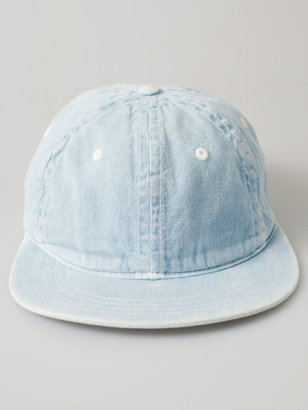 We can't think of a cooler way to cover up from the rain or (too much) shine.  American Apparel Unisex Denim Basic Cap ($29)