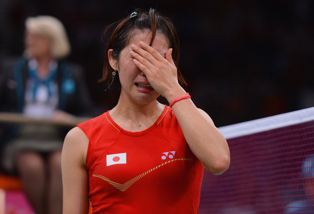 Japanese badminton player Sayaka Sato cried after having to withdraw due to an injury.