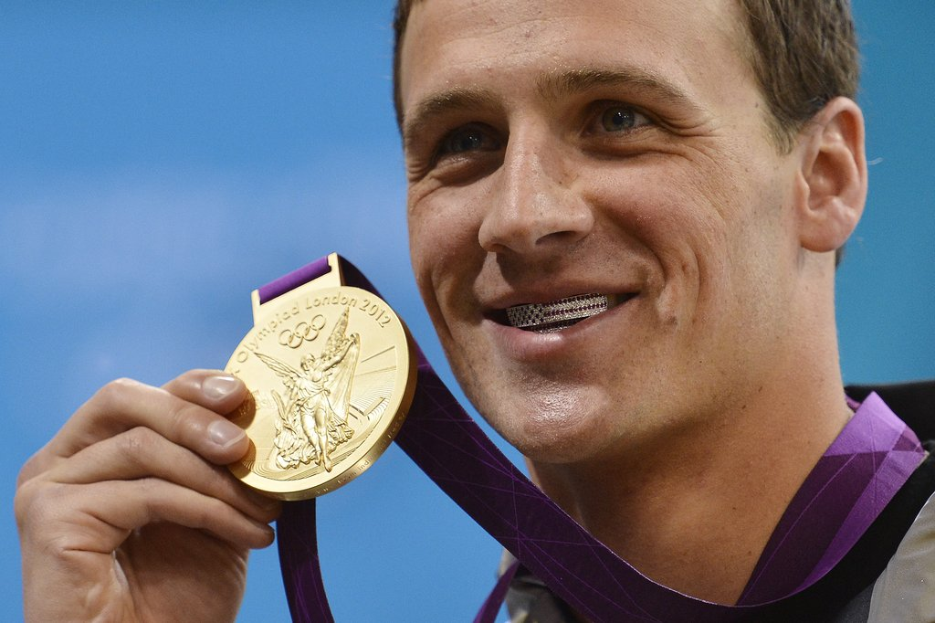 "Ryan flashed his American-flag grill and his gold medal. He's described it as ""a retainer filled with diamonds."""