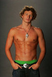 I'm not so sure about that blinged-out necklace in this pic for the 2008 Olympic team, but seeing those abs, I'll forgive him.