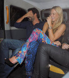 Bar Refaeli and a male companion cracked up in their cab.