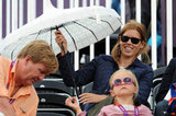 Princess Beatrice brought out her umbrella.