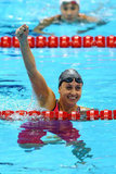US swimmer Rebecca Soni put her hand in the air after winning gold and setting a new world record time in the 200m breaststroke final.