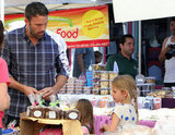 Ben Affleck stopped at a food stand with Seraphina and Violet.