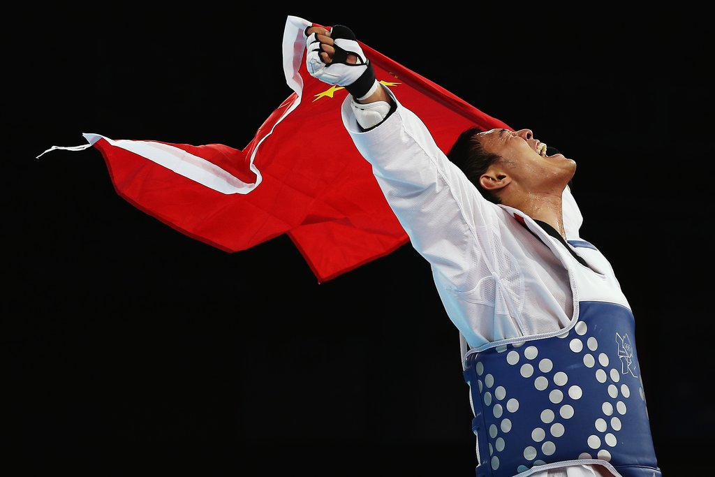Taekwondo fighter Xiaobo Liu of China celebrated his win.
