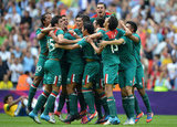 Mexico's soccer players embraced after winning gold.
