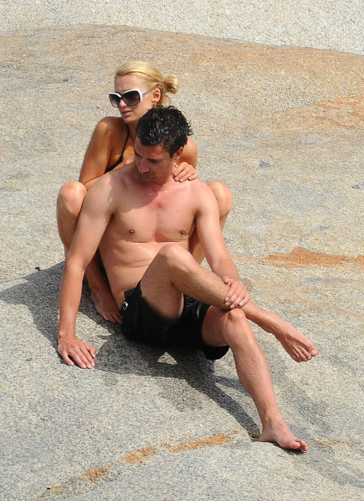 Paris Hilton and her mystery man soaked up the sun.