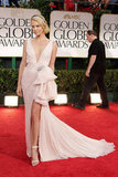 Charlize Theron showed some leg in a Dior dress at the Golden Globes in January 2012.