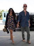 Matthew McConaughey wore a denim shirt and baseball cap to travel with Camila Alves out of LAX.