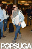 Kate Hudson wore heels to travel.