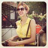 Her colourful head scarf added an extra dose of vibrancy to her already bright yellow dress ensemble.