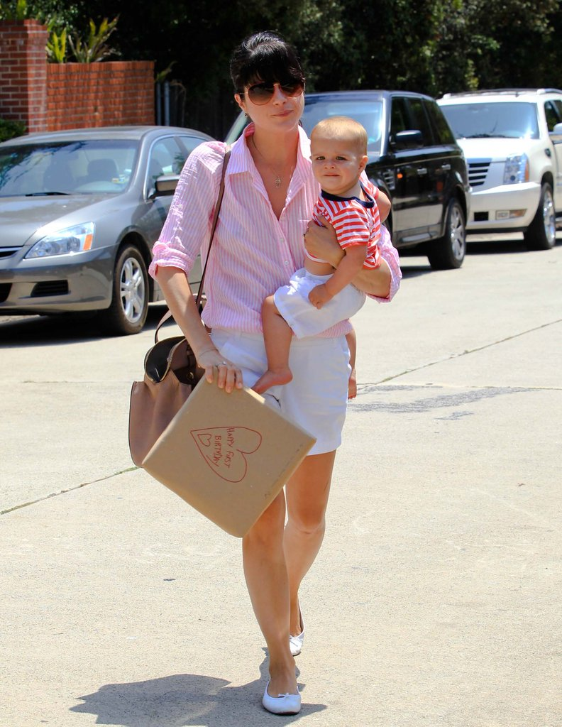 Selma Blair carried son Arthur in her arms on the way to a birthday party in LA.