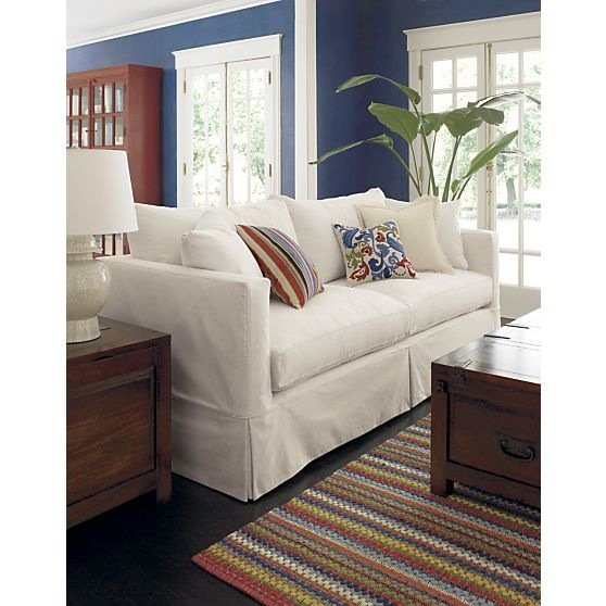 The versatility of a white slipcovered sofa should never be underestimated. Switch out throw pillows and add a chunky knit throw for an instant Fall update. The clean lines of this white sofa ($1,799) make it sophisticated enough for an urban dwelling.