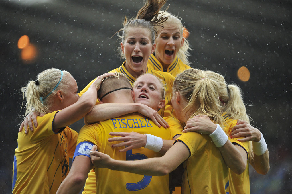 Sweden teammates jumped for joy during the women's soccer quarterfinal match against France.