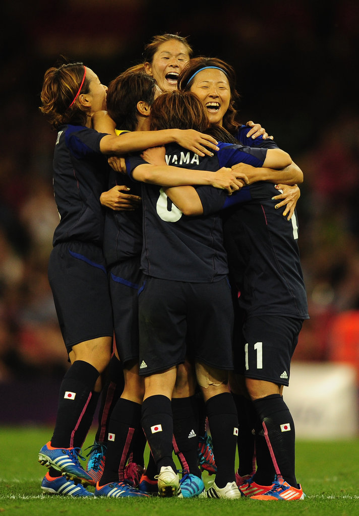 The Japanese women's soccer team huddled together during their game against Brazil.