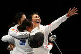 Fencing teammates from China were ecstatic after winning gold.
