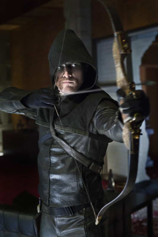 Stephen Ammell wears a hoodie as Green Arrow on Arrow.