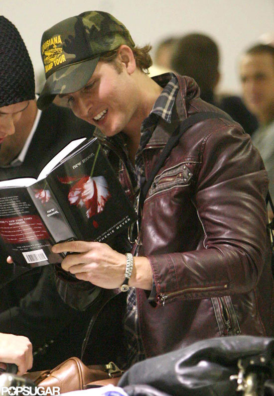 Peter Facinelli brushed up on his source material by perusing New Moon at LAX in April 2009.